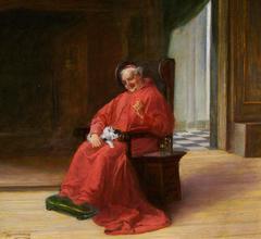 A Cardinal with a kitten