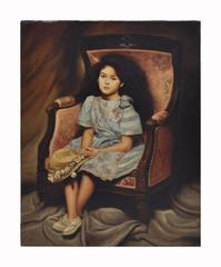 CHILD ON THE ARMCHAIR