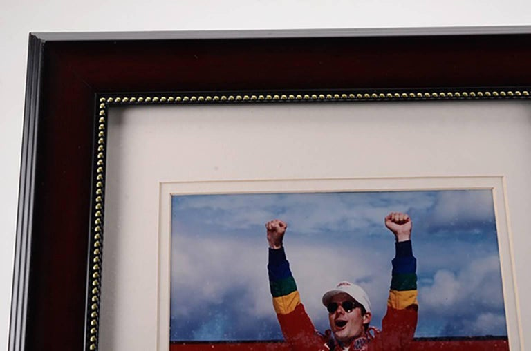 Unique framed Jeff Gordon racing photograph hand signed by Jeff Gordon in blue marker  The autograph has been professionally authenticated by Upper Deck with sticker hologram affixed to the photo  An accompanying Upper Deck certification is enclosed