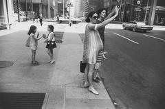 New York, (two women hailing cab)