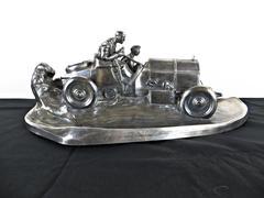 A RACING CAR DESKPIECE BY WMF, GERMAN