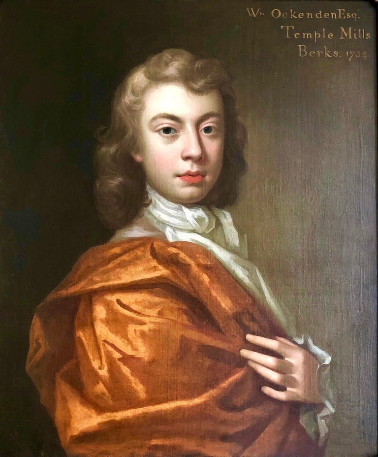 18th Century Portrait of William Ockenden in an Orange Robe.  Fine, sensitively rendered early/mid 18th century portrait of William Ockenden, of Temple Mills Berkshire, half length wearing a russet brown Mantle with a White Cravat. Signed and