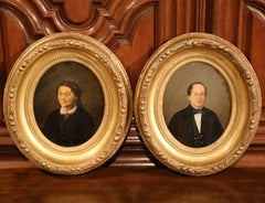 Pair of 19th Century French Oil Portraits in Carved Oval Gilt Wood Frames