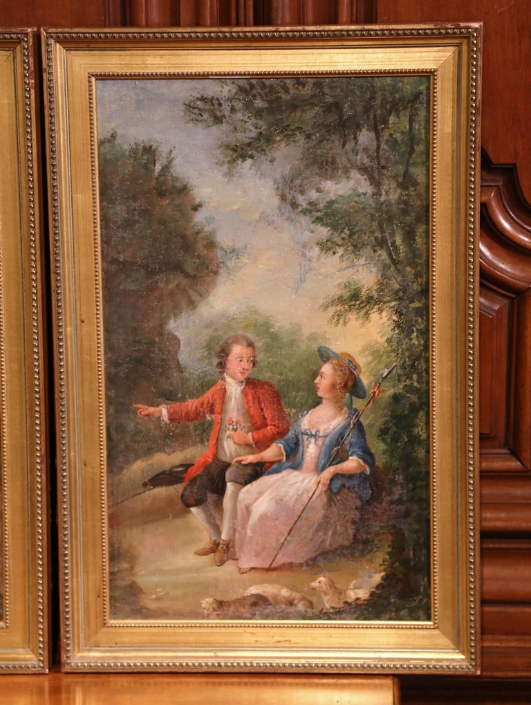 This beautiful pair of antique paintings were crafted in France circa 1780. The courtly, pastoral scenes take place in the fields and illustrate two different courting scenes. Dressed in elegant Louis XV costumes, the figures in each painting are