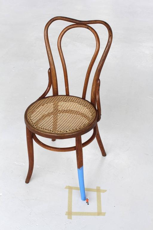 Untitled (man painting chair II)