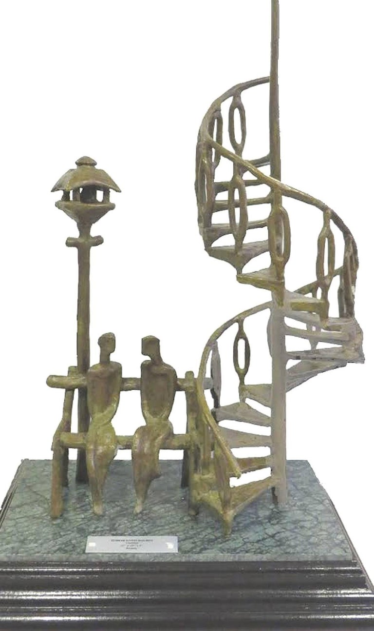 Tushar Kanti Das Roy - Sweet Nothings - 22 x 10 x 4 inches Bronze Sculpture.  Here Tushar Kanti has beautifully depicted the romance of Bengal not only in the figures but also its location , a street lamp and the beautifully bengali spiral stairs