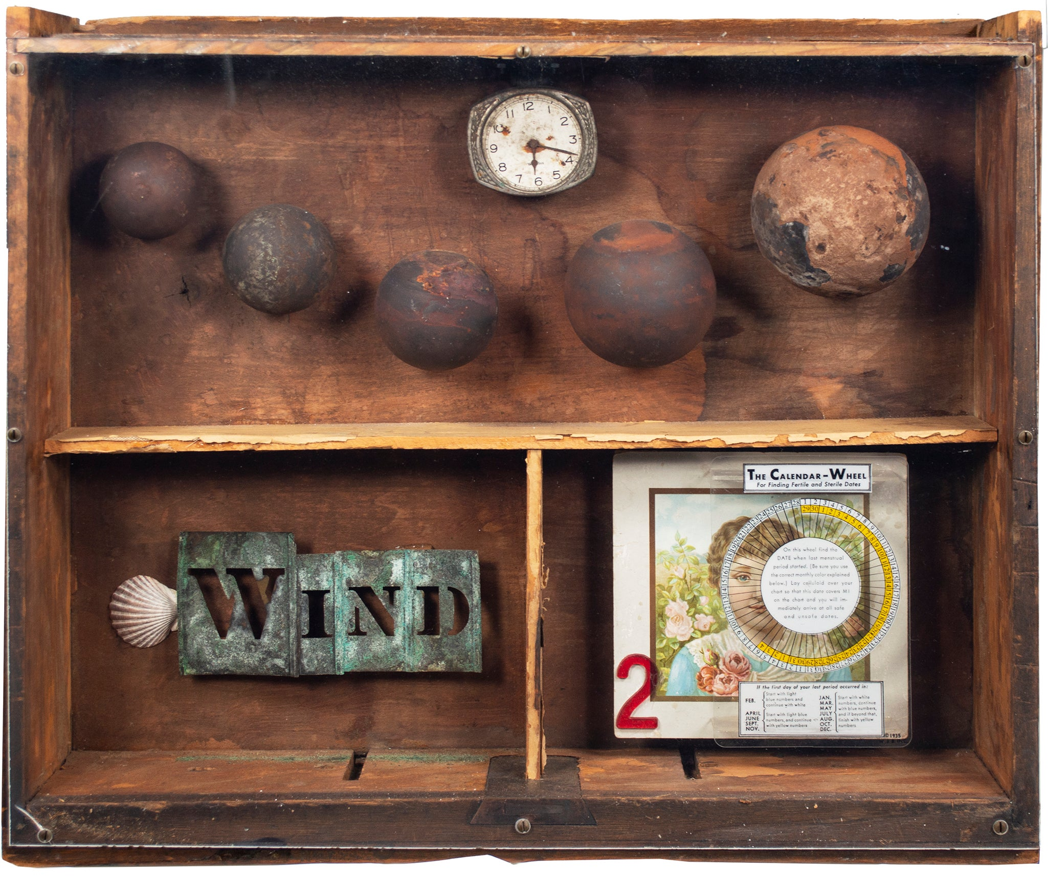 'The Calendar Wheel' assemblage in drawer with spheres clock shells cards