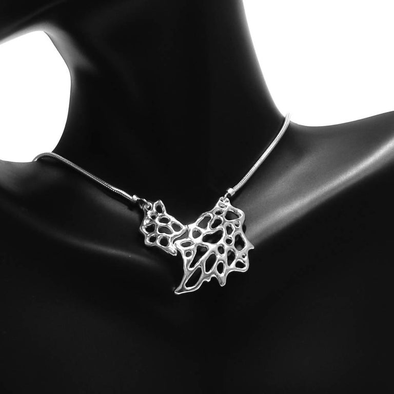 This beautifully detailed Sea Fan pendant is handcrafted in sterling silver and features a silver snake chain. Inspired by the organic shape of coral, this complex pendant is a delicate statement. In bright silver, the Sea Fan design is a tribute to
