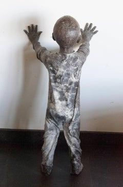Niño Apoyado en la Pared,  a sculpture