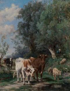 Vaches et les moutons par l'eau