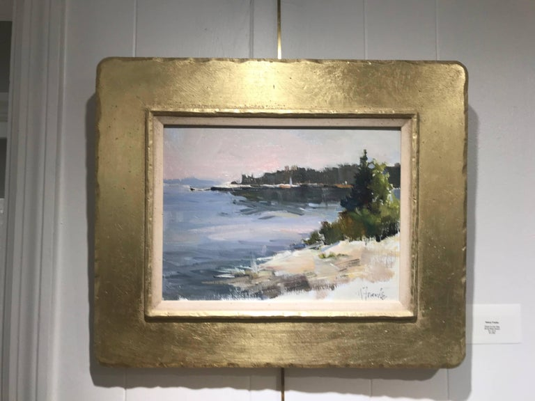 American artist Nancy Franke created this framed oil on linen board painting entitled 'Sparkling Morning in Maine' in 2017. Featuring a seaside scene, the artist chose a muted palette made of light browns, beiges, greens and blues to depict a coast