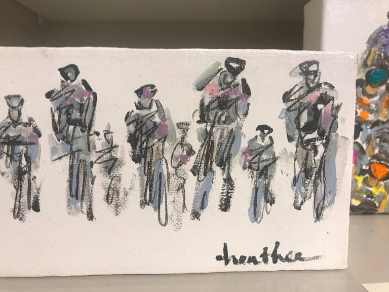 'Cyclists I' is a thin horizontal mixed media on canvas sports painting created by American artist Heather Blanton in 2018. In a perfectly organized manner, this contemporary painting features a peloton of cyclists riding in our direction. Born in