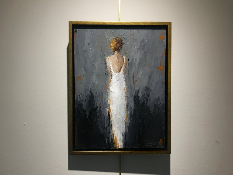 'Zoe' is a petite framed Impressionist oil on painting canvas created by American artist Geri Eubanks in 2018. Featuring a vertical format, the painting depicts a woman seen from the back and wearing an elegant white gown revealing her delicate back