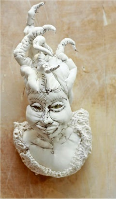 Mascarons I, white and whimsical fabric wall sculpture, by Anne Valérie Dupond