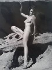 Nude sit on a Rock