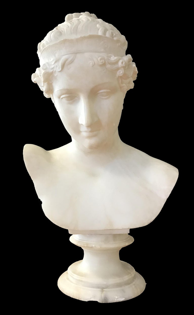 Beautiful and elegant Bust of Young Woman realized in Carrara Marble by a follower of Antonio Canova, Italy Early 19th Century. It represents a young woman slightly inclined wearing a diadem and with hair combed in Neo-classic style, cut on