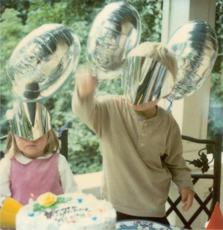 Stefanie Schneider Figurative Photograph - Boy with Silver Mask - Stay