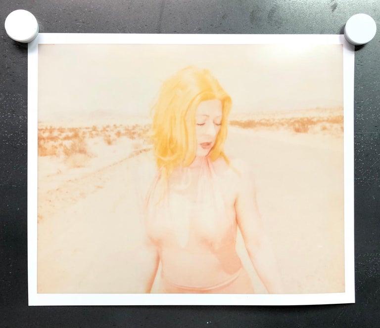 Stefanie Schneider Figurative Photograph - Max hitches into Town (29 Palms, CA), 21st Century, Polaroid, Portrait Photograp
