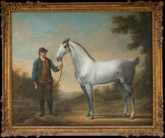 A Grey Stallion Being Held by His Groom in a Classical Landscape