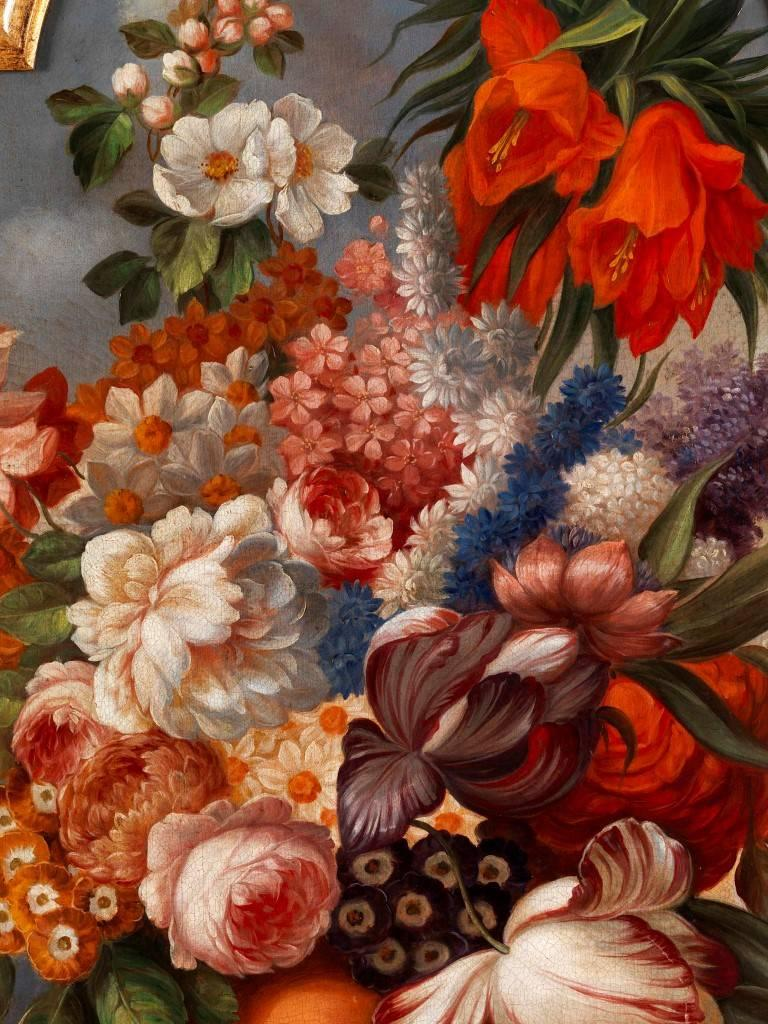 These beautiful antique oil on canvas paintings are still as beautiful today as they were roughly 250 years ago when they were painted. Depicting beautifully arranged bouquets of flowers in vases positioned at the end of tables, each painting is