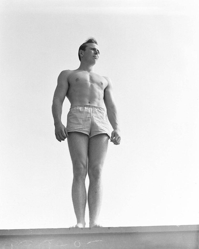 Bob Mizer Portrait Photograph - Unknown on Platform, Santa Monica