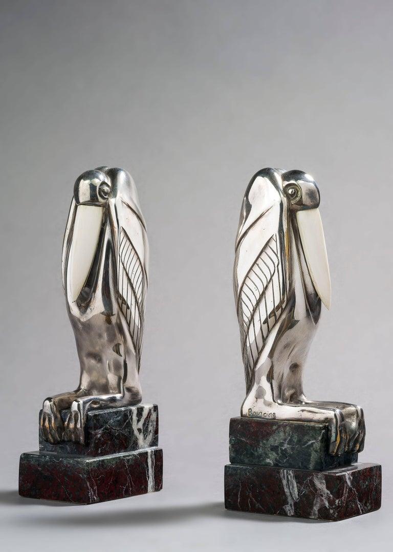 Marcel-André Bouraine Figurative Sculpture - Serre livres aux Marabouts