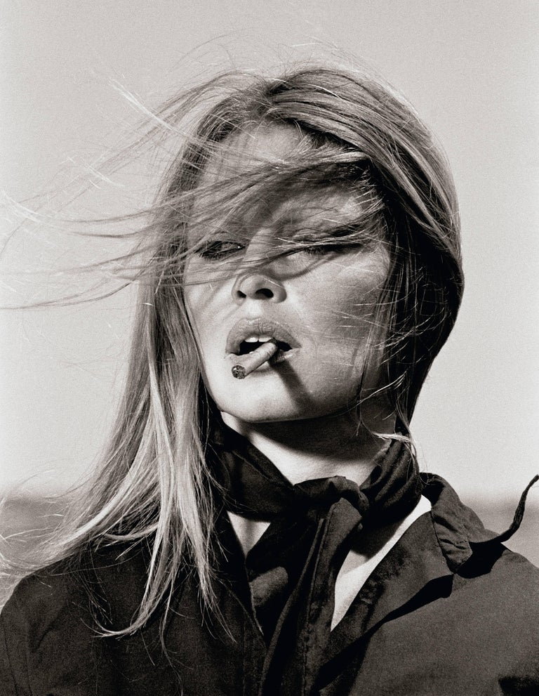 Terry O'Neill Black and White Photograph - Co-Signed Brigitte Bardot with Cigar
