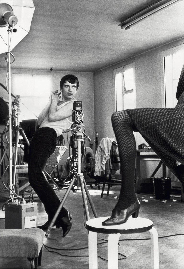 British photographer David Bailey gives instructions to model Moyra Swan, circa 1965. Signed and numbered by the photographer in a limited edition of 50 plus 10 APs per size.  Terry O'Neill is one of the world's most collected photographers with