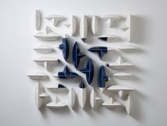 Blue and white ceramic porcelain wall sculpture installation by Maren Kloppmann