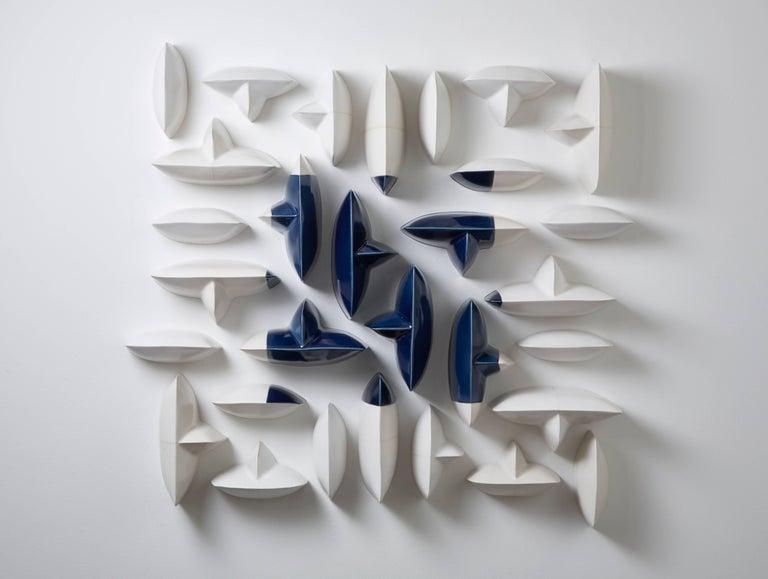 Blue and white ceramic porcelain wall sculpture installation by Maren Kloppmann 1