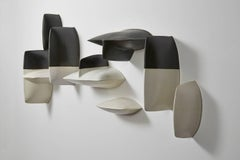 Bronze black and white porcelain wall installation sculpture by Maren Kloppmann