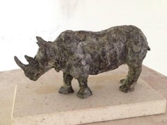 Ironclad - contemporary rhinoceros animal bronze sculpture on pedestal