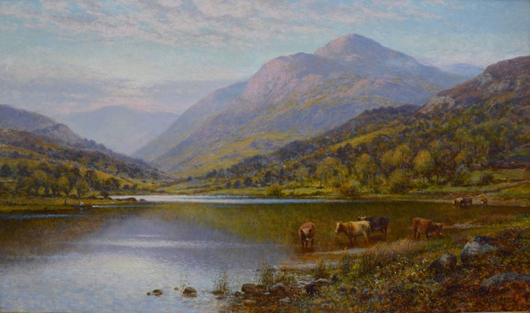 This is a fine 19th century oil on canvas depicting a spectacular Scottish Highland landscape with cattle watering at the shoreline of a loch in summertime by the famous Victorian artist Alfred Augustus Glendening Snr. (1840-1910). The painting is