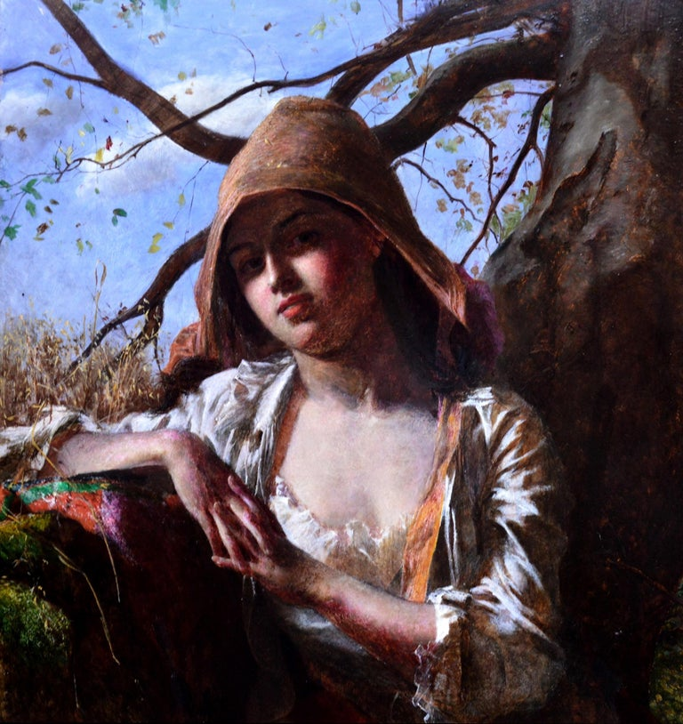 This is a fine mid-19th century Pre-Raphaelite oil painting depicting 'A Country Lass' be the eminent British artist Frederick Smallfield ARWS (1829-1915). The painting is signed by the artist with his monogram and hangs in its original Victorian