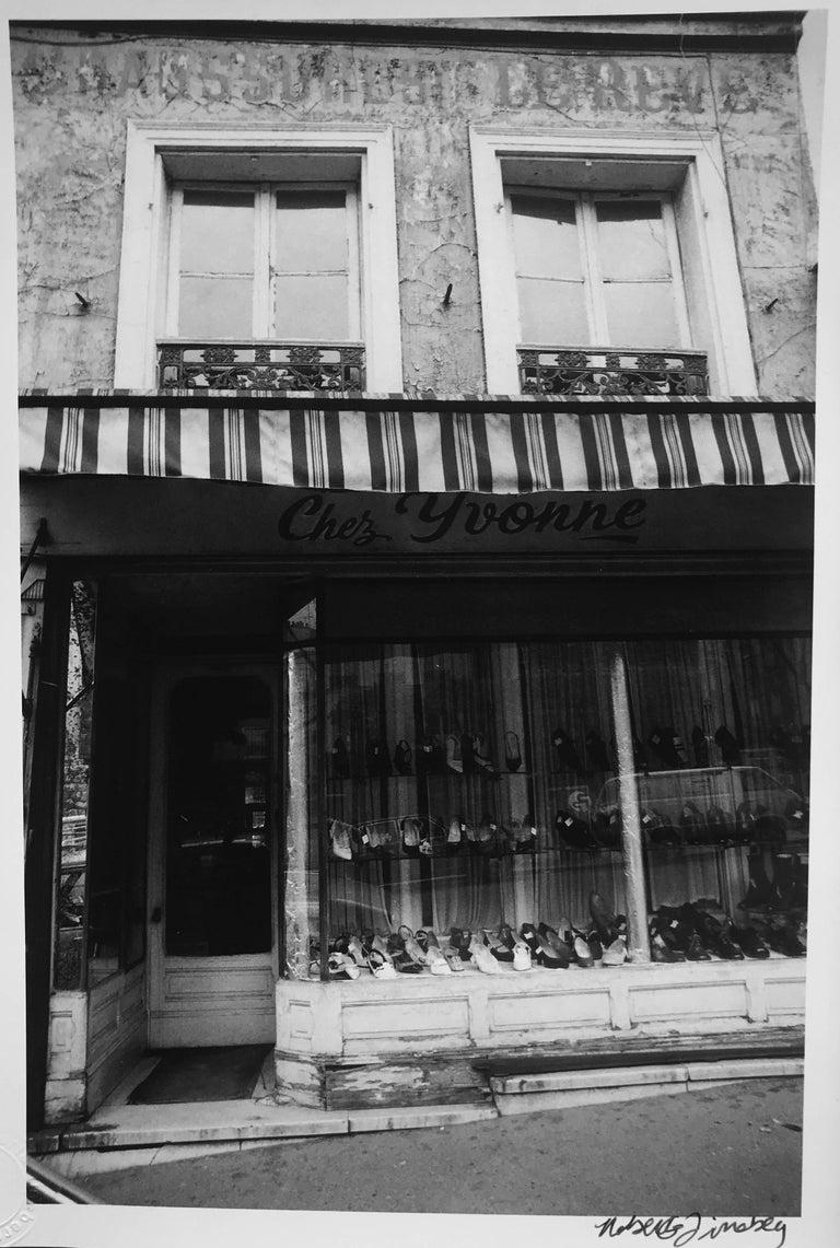 Roberta Fineberg Landscape Photograph - Chez Yvonne, Shoe Shop, France, Black and White Photograph Paris 1980s