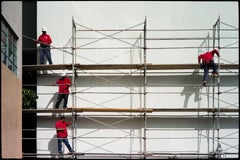 A Scaffold of Men in Red