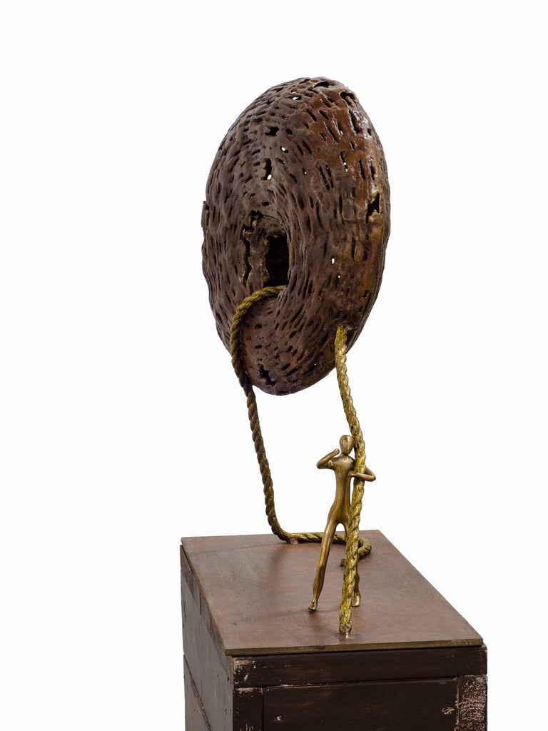 The Baggage. Bronze sculpture with brown - golden patina by Beatriz Gerenstein