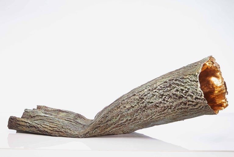 Container (2014) is a work by contemporary French artist Romain Langlois.  Bronze, 39 cm × 106 cm × 26 cm. Edition of 8 & 4 A.P. In this bronze sculpture, Romain Langlois has produced a really realistic imitation of tree bark. The textures are