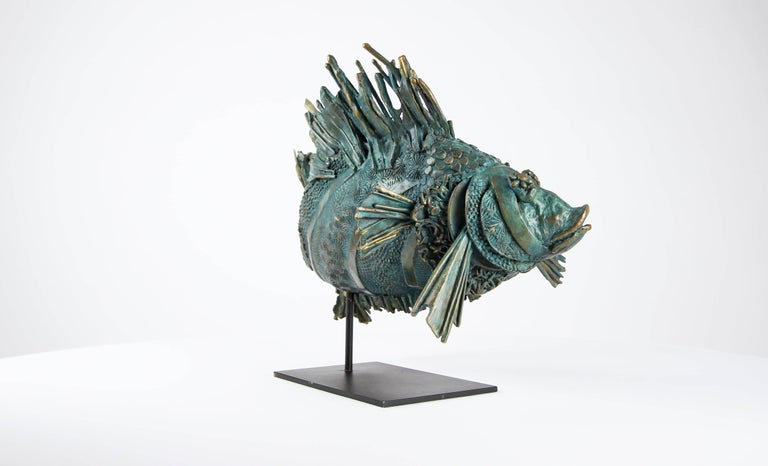 "Love Fish is a one-off bronze sculpture by contemporary artist Chésade, which represents a green-blue and golden fish. It is representative of the sculptor's interest in the marine world.  Chésade regards the sea as ""a conservatory of exoticism"