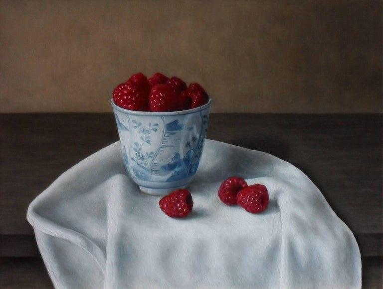 'Raspberries in a Bowl' by Barbara Vanhove is a 20th Century  Photo-realist still-life painting.  Barbara was born in Watermael-Boisfort in Belgium in 1974. She showed an incredible natural talent early on in her life and after school she studied