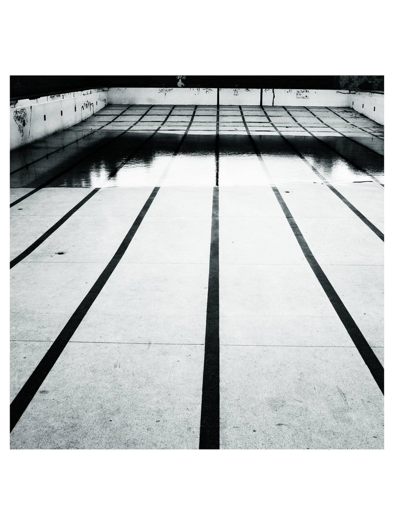 Leandro Feal Black and White Photograph - What time is it over there? (pool)