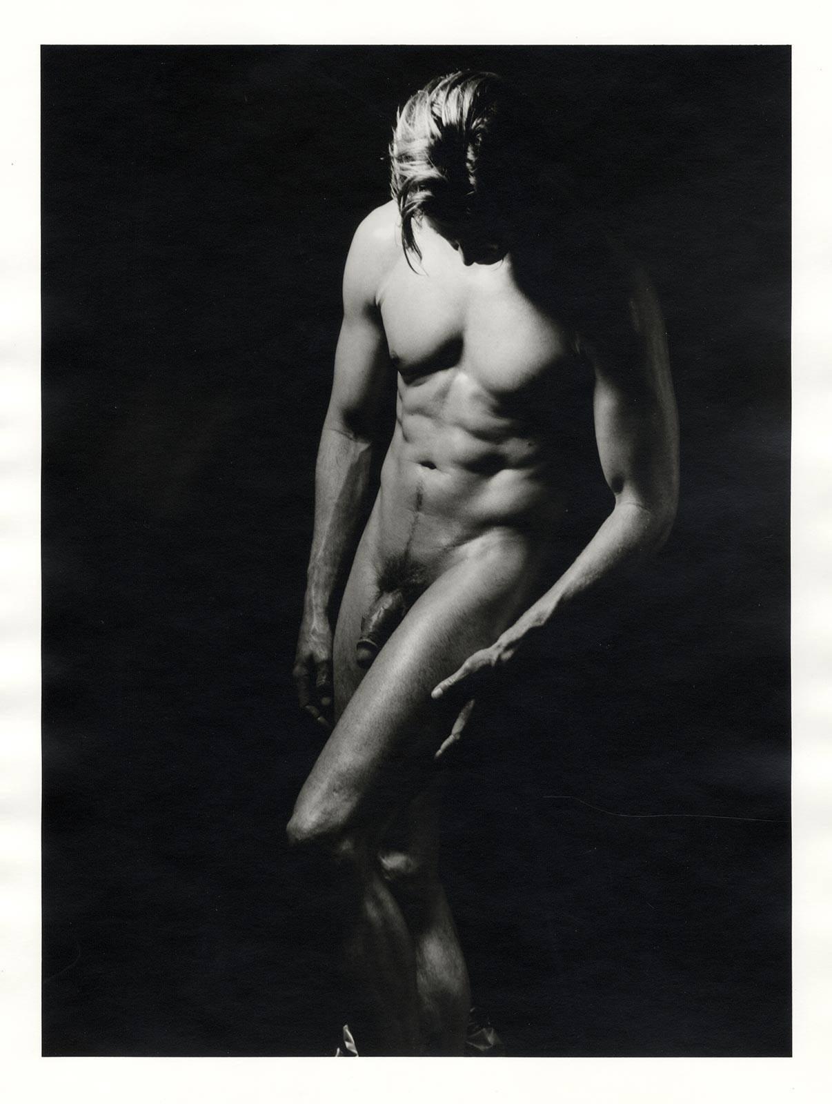 Photographers taking erotic male photos