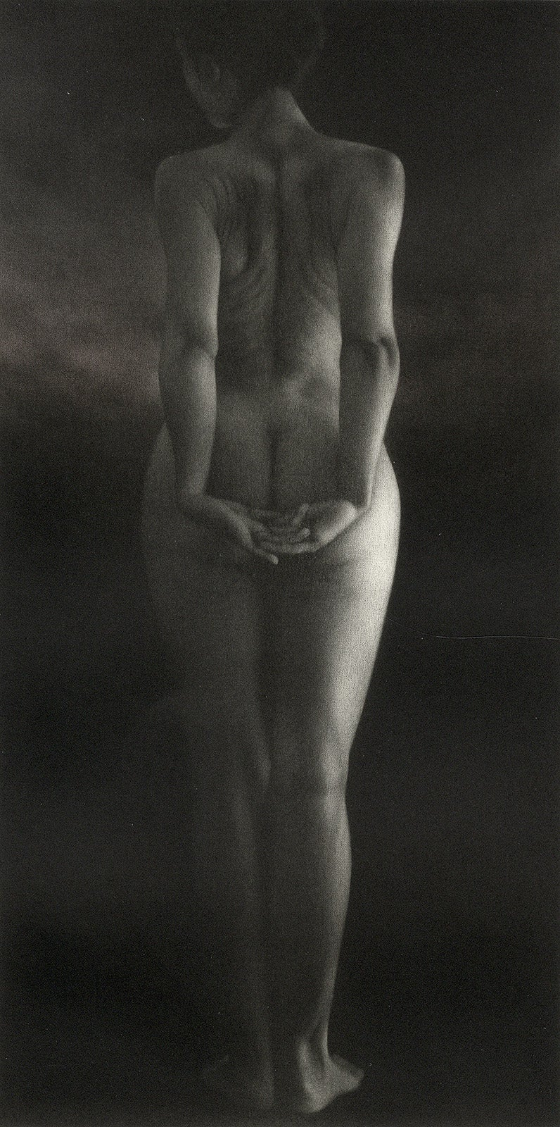 Crepuscule (literally means Dusk. Standing young nude woman facing away)