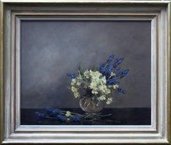 Primroses and Grape Hyacinths - British oil floral still life female artist