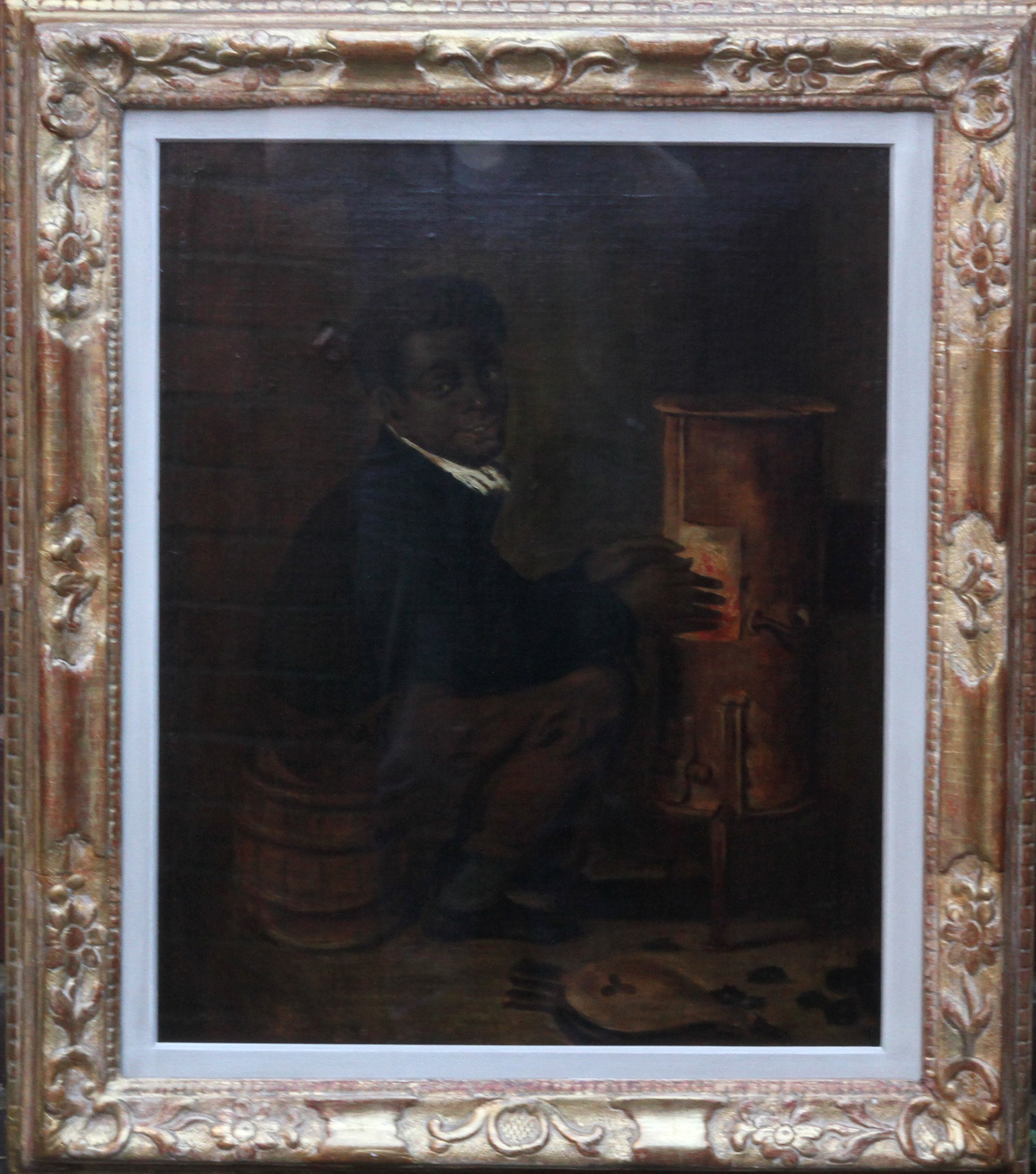 Black Boy Warming Himself by Stove - American School 19thC portrait oil painting