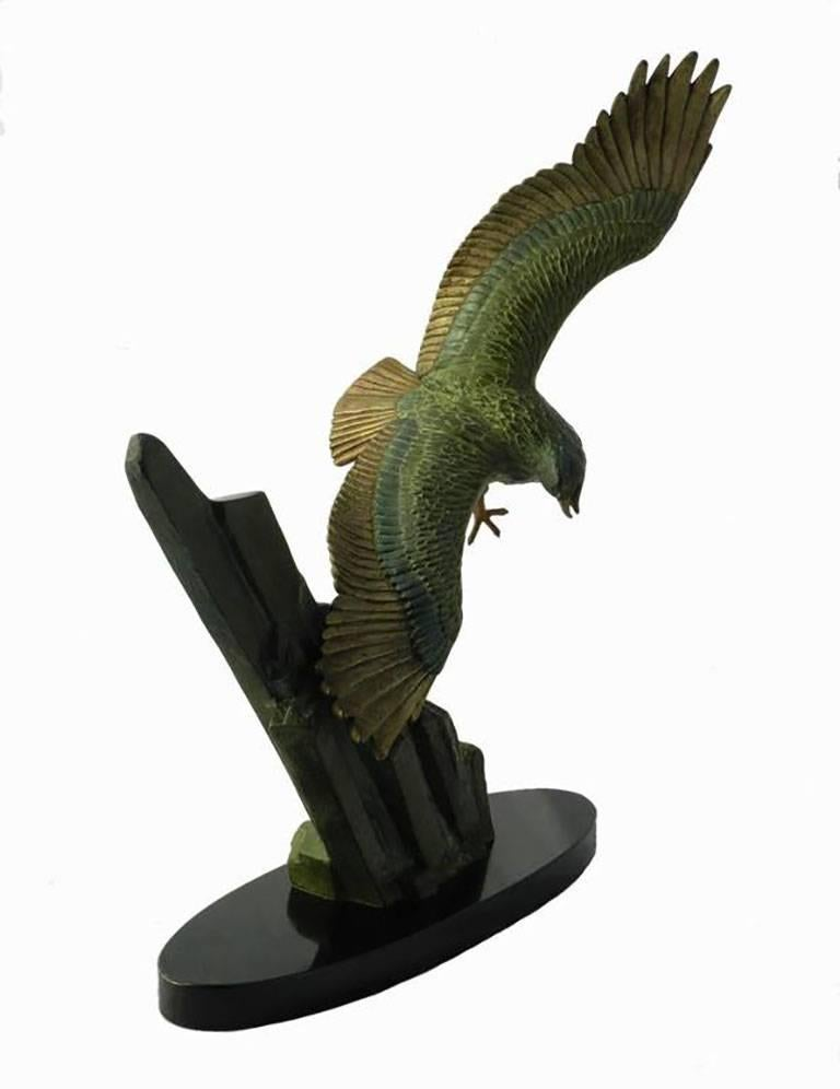 Art Deco Eagle statue by Rulas. Signed to the base. Good original patinated green and gold metal on black marble base. Rulas is also known for his feline and panther statues was an animalier sculptor from the 1930s this rare eagle sculpture is