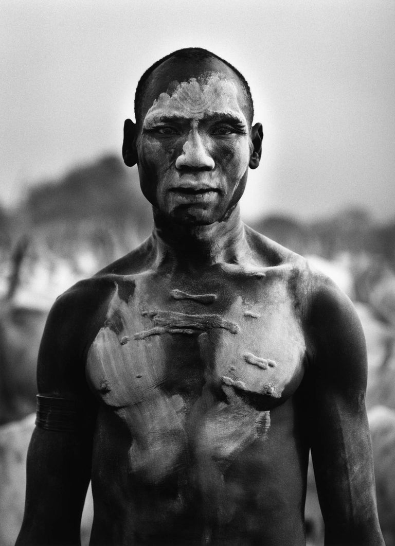 Dinka Man, Southern Sudan, 2006 Sebastião Salgado Stamped with photographer's copyright blind stamp Signed, inscribed on reverse Silver gelatin print 16 x 20 inches  Undertaking projects of vast temporal and geographic scope, Sebastião Salgado (born