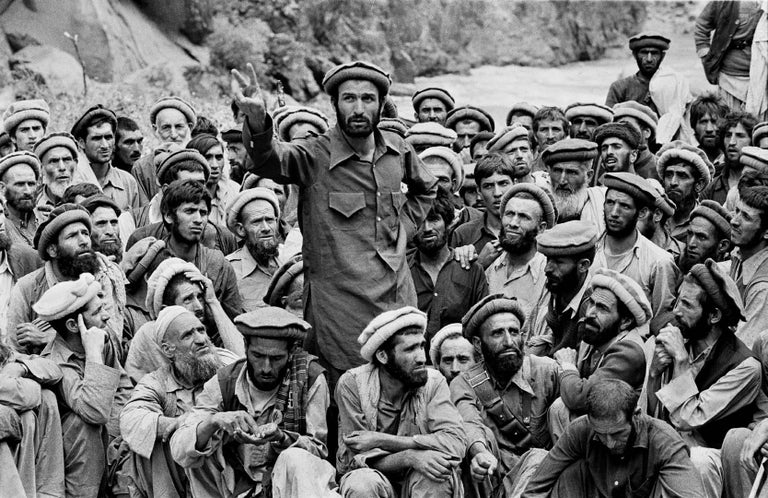 Steve McCurry Black and White Photograph - Mujahideen Leader Speaks to Fighters, Afghanistan, 1980