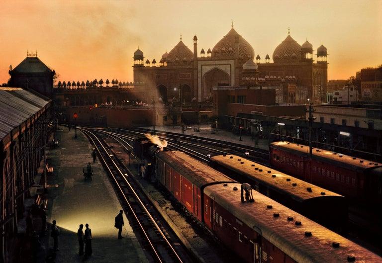 Steve McCurry Color Photograph - Train Station, Agra, India