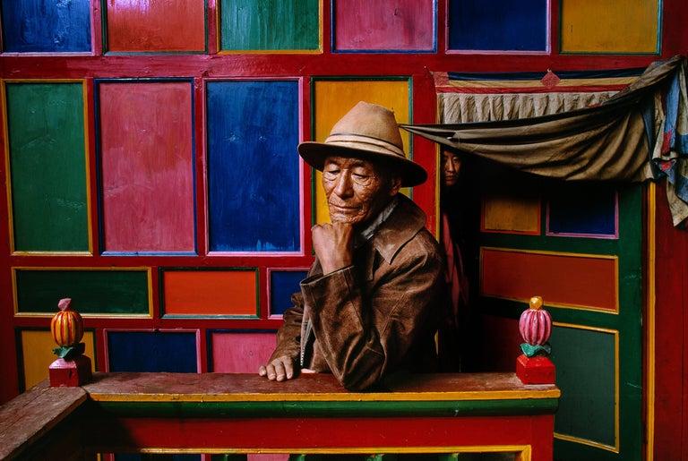 Steve McCurry Color Photograph - A Pilgrim in Drango Monastery, Tibet
